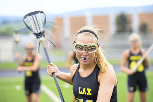 bee happy childrens dentistry girl playing lacrosse with mouthguard